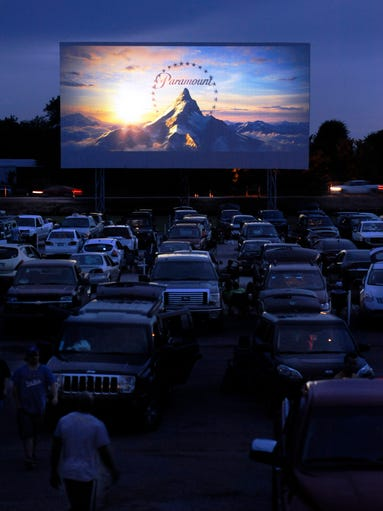Cars fill the Franklin Drive-In movie theater as a movie begins on Friday, June 27, 2014, in Franklin, Ky.