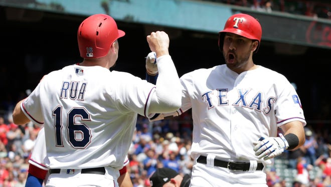 Texas Rangers third baseman Joey Gallo (13) celebrates with first baseman Ryan Rua (16) after hitting a three run home run in the second inning against the Oakland Athletics at Globe Life Park in Arlington.