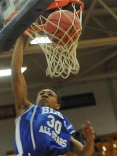 McDowell alum Raekwon Miller dunks during the 2014 Blue-White All-Star boys basketball game.