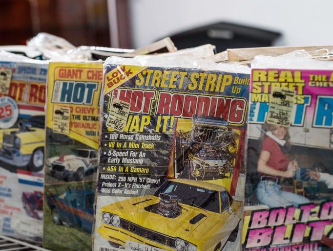 Vintage car magazines are seen inside Grandpa's Garage,