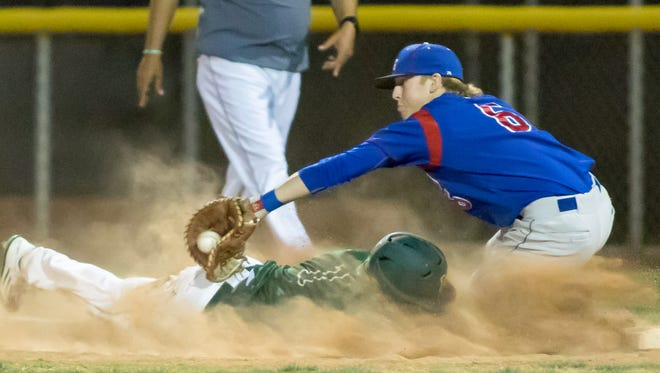 Mayfield's Michael Contreras is out at first by Las Cruces High first baseman Payton Ball.