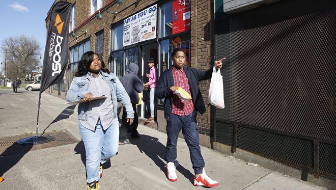 Arquan Smith, 17, right, and Mikalah Johnson, 16, head down Chili Avenue in May 2014 looking for businesses that will take a survey on teen jobs in Rochester. It was part of a job outreach program by Teen Empowerment Rochester.