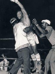 Boxing at coliseum: Frankie Warren's corner celebrates