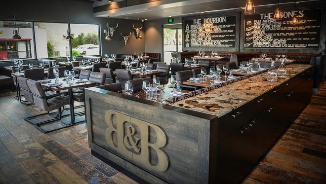 The rustic bar inside Bourbon & Bones in Phoenix.