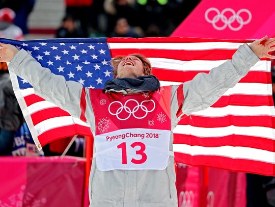 Kyle Mack celebrates winning silver in the men's snowboard big air finals. Peter Casey | USA TODAY Sports