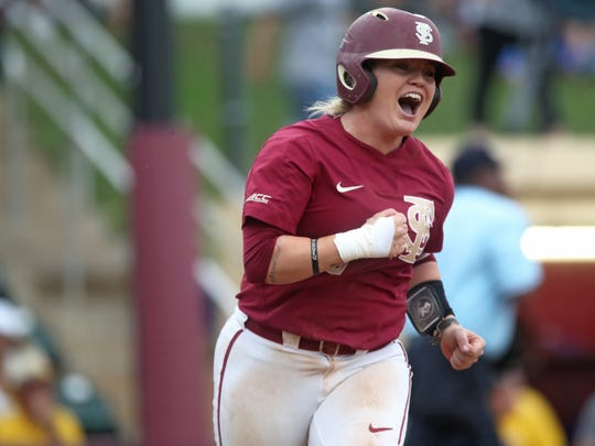 FSU's Jessie Warren celebrates after hitting a 2-run