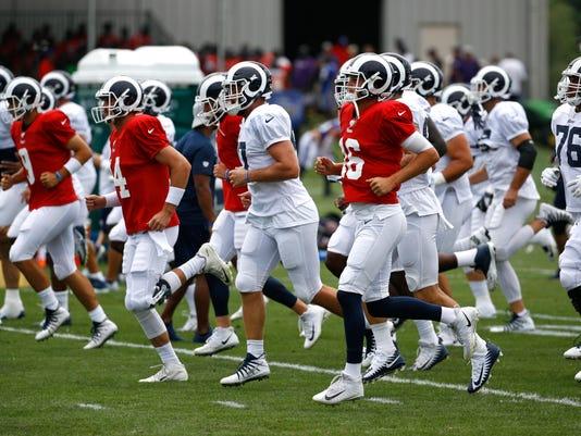 Rams_Ravens_Practice_Football_37115.jpg