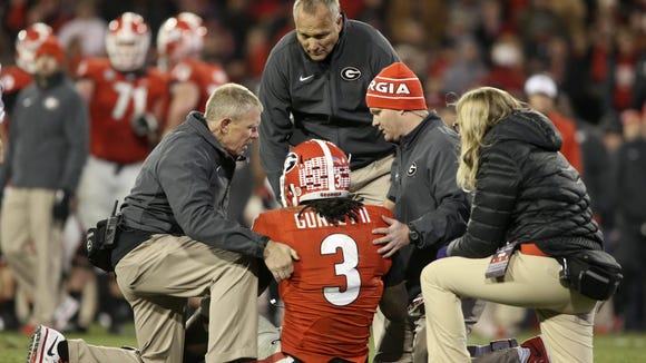 Former Georgia running back Todd Gurley tore his ACL against Auburn but does not regret returning to play.