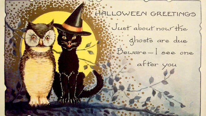 This vintage Halloween postcard with a cat and an owl is from the early 1900s.