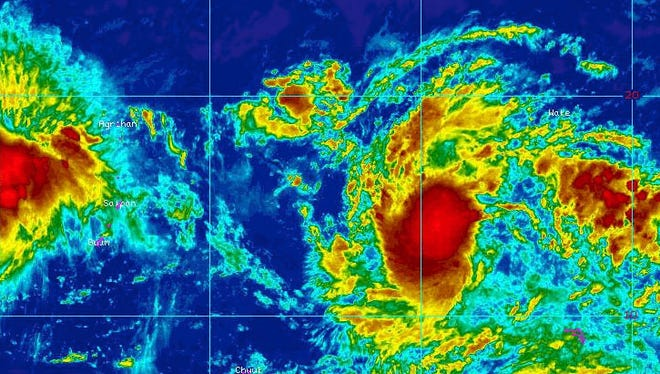 An Oct. 13 infrared image from the National Weather Service shows a tropical disturbance about 1,200 miles east of Guam. The system is expected to pass over the Marianas sometime in the next few days.