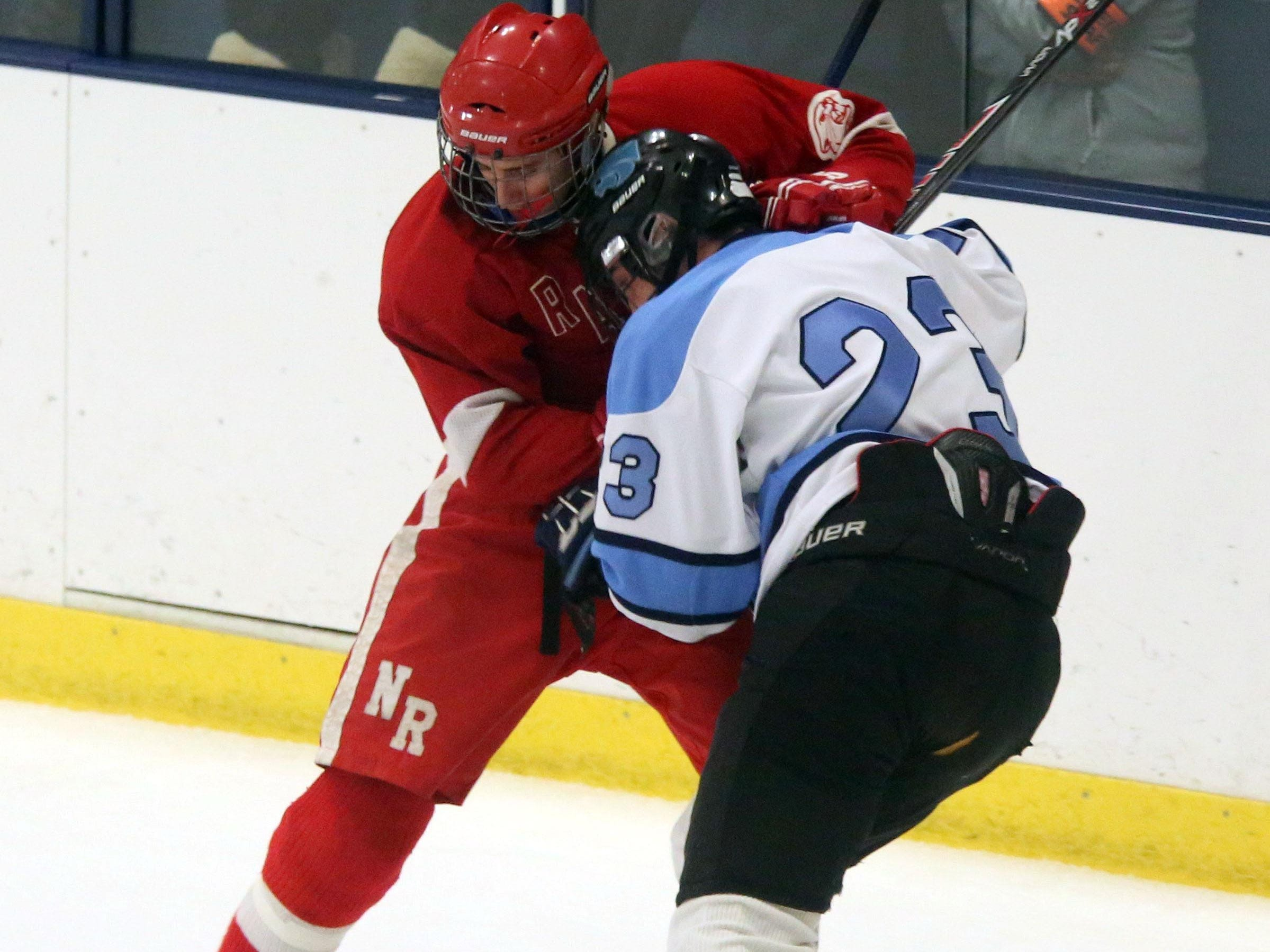 Suffern's CJ Greco (23) and North Rockland's Chris Vasquez (80) fight for control of the puck during the first period Section 1 Division 1 semifinal hockey at the Sport-O-Rama in Monsey at Feb. 26, 2016.