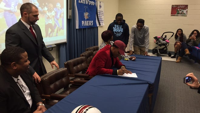 Lakewood's Amir Tyler signing his national letter of intent to attend Temple University.