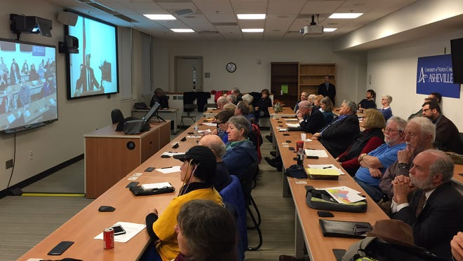Area residents packed a conference room at UNC Asheville Monday for a public hearing on North Caroilna's U.S. House district held by teleconference at sites around the state.