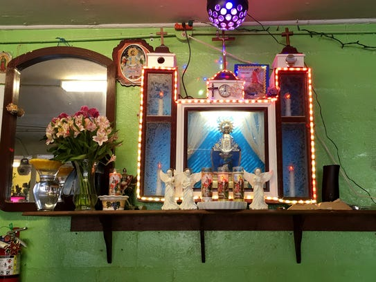 The dŽecor inside the restaurant, including an altar