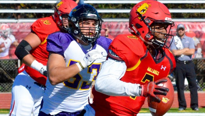 Ferris State quarterback Reggie Bell rushes away from defenders during Saturday's game against Ashland at Top Taggart Field.
