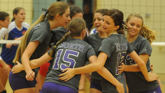 North Henderson's volleyball team during a 2013 match.