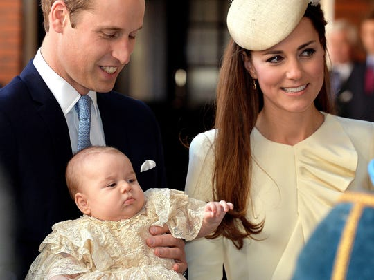 Prince George with his parents on day of his christening,