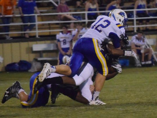 Buckeye senior linebacker Nick Green (12) tackles a