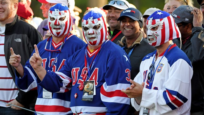 U.S. fans try to draw some attention in the Ryder Cup at Hazeltine National Golf Club.
