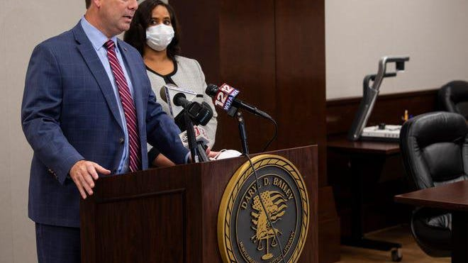 District Attorney Darryl Bailey and Chief Deputy District Attorney Lloria James announces a warrant for State Rep. Will Dismukes at the District Attorney's Office in Montgomery, Ala., on Thursday, Aug. 6, 2020.