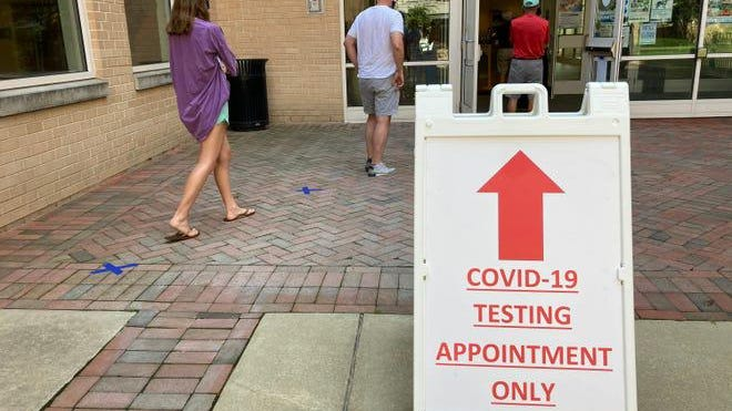 Montgomery County residents wait in line to be tested for the COVID-19 coronavirus at a testing site in Chevy Chase, Maryland on July 8.