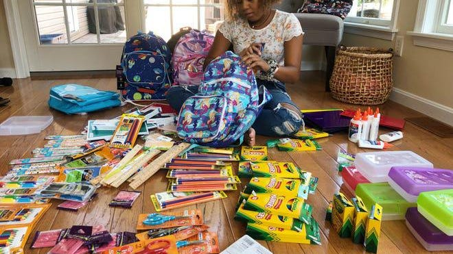 Aaliyah Reynolds buys backpacks for her 2020 campaign. PROVIDED PHOTO