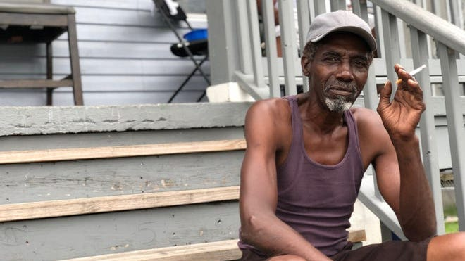 Webster Rainy, 68, was rescued by helicopter from a rooftop in New Orleans' Lower 9th Ward after Hurricane Katrina in 2005. He's not evacuating for storms Laura or Marco, saying he's more confident in nearby levees and floodwalls.