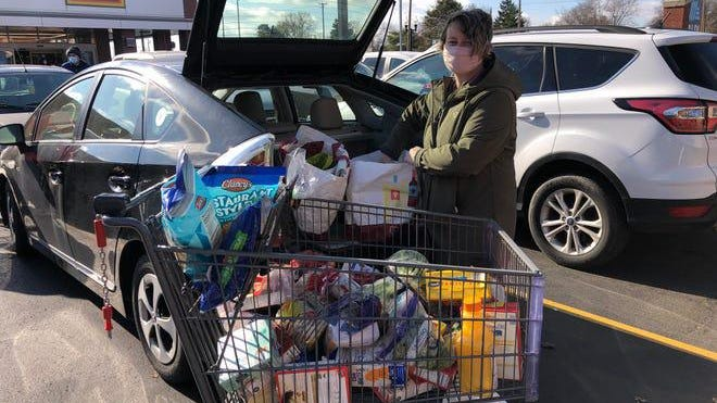 Val Grant of Wyandotte shopped as usual on Monday though she noticed Aldi in Wyandotte appeared to be more crowded.