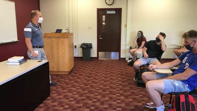 Phillip Andre teaches a class of first-year students at Alma College in late August.