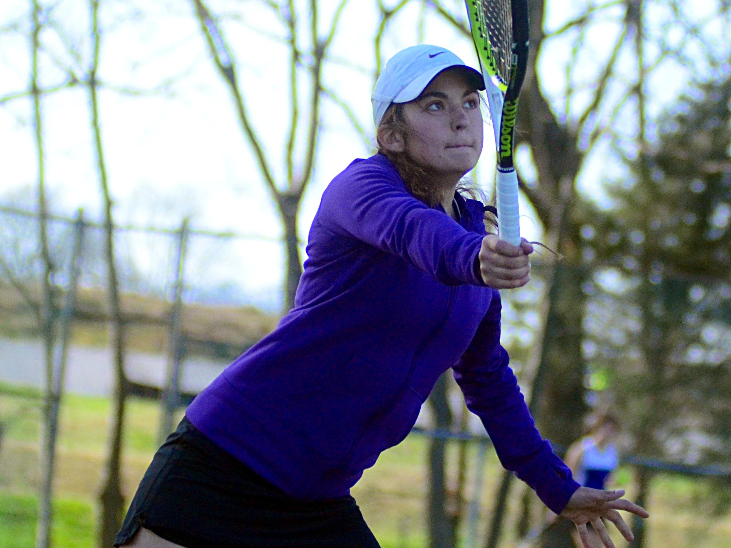 Merrol Hyde Magnet senior Lauren Heinrich hits a volley near the net during Tuesday afternoon's match against Station Camp. Heinrich won her singles match, but the Lady Hawks suffered a 7-2 loss to Station Camp.