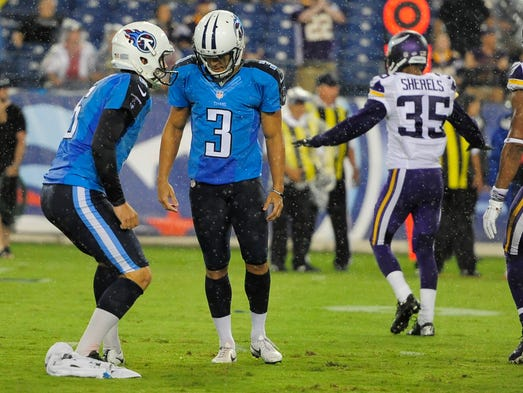 Titans kicker Maikon Bonani (3) looks to the ground after missing a field-goal attempt against the Vikings during the first quarter Thursday.