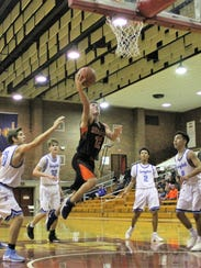 Silverton sophomore David Gonzales drives to the basket