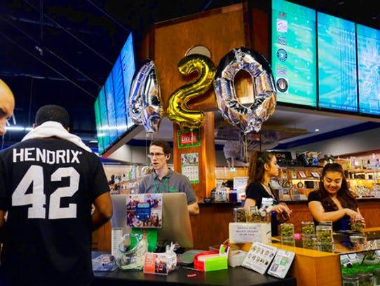 Customers gather around a counter to take advantage