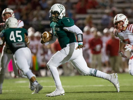 King's quarterback Elijah Flowers runs the ball for a touchdown during the first quarter of their game against Ray at Buccaneer Stadium on Friday, Nov. 4, 2016.