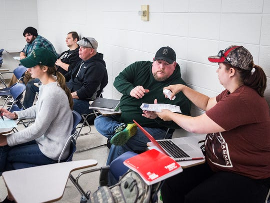 Iraq war veteran Patrick Weber attends his policy class in the Cooper Science Building at Ball State Thursday afternoon. Weber, who served three tours in Iraq and served for 20 years in the army, suffers from severe PTSD.