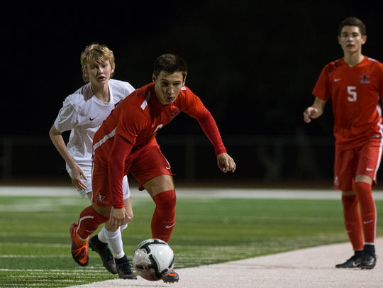 Ray's Seth Korenek runs after the ball during the second