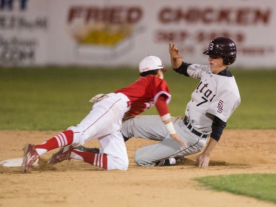 Sinton's Brett Brown is tagged out at second base by Robstown's Jessie Gonzalez during the third inning of their game at Steve Castro Field in Robstown, on Friday, March 17, 2017.