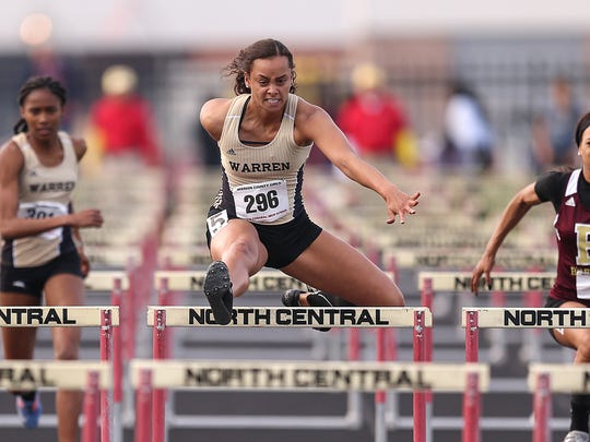 Center, Warren Central senior Kayland Jackson sets the new meet record for the 100 meter hurdles in 14.27, during the Marion County girls track and field championship at North Central High School, Indianapolis, Tuesday, May 9, 2017.