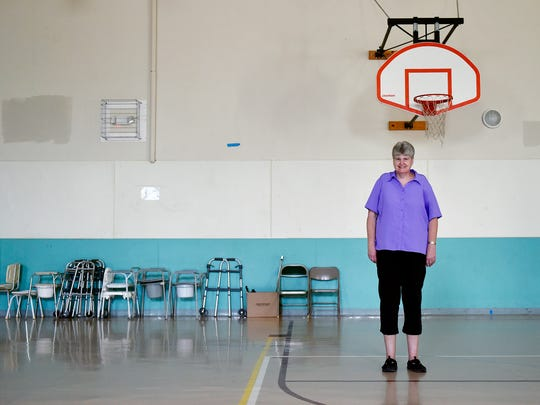 Kim Maglaughlin, director of the Delta Area Community Senior Center, stands for a portrait in the center's gym, whose wall is lined with crutches and walkers, Thursday, June 1, 2017. Exelon's Peach Bottom Atomic Power Station nuclear power plant drives much of the surrounding area's economy, especially in the borough of Delta in southeast York County. Maglaughlin said the power plant has helped the senior center financially and with maintenance work, such as an upcoming week of community service during which volunteers will repaint this gym's walls.