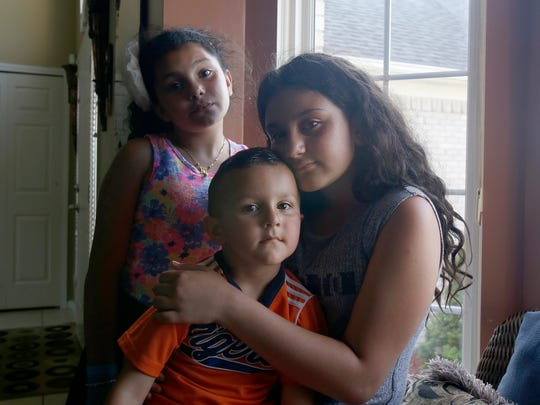 Siblings from clockwise, Meryana Butris, 9, Lilly Butris, 12, and Eli Butris, 3, at their home on Monday, June 12, 2017 in Sterling Heights. Their father Joe Butris was picked up by ICE and detained on Sunday, June 11, 2017.