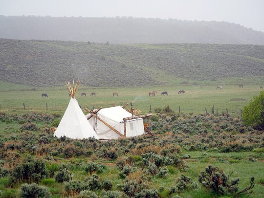 A Collective Retreats tent sits alone in a Colorado