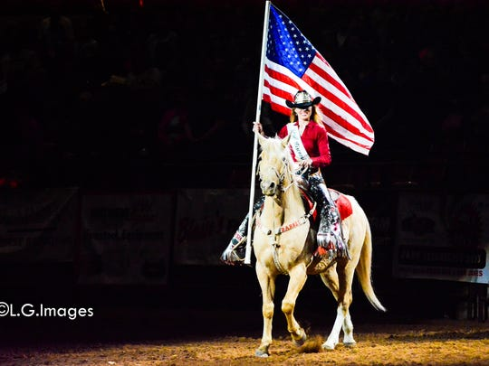 Miss Rodeo Wisconsin, Katelin Bradley, carries the