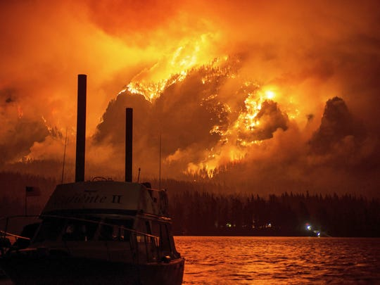 The Eagle Creek wildfire is seen from Stevenson, Washington, across the Columbia River, burning in the Columbia River Gorge above Cascade Locks.