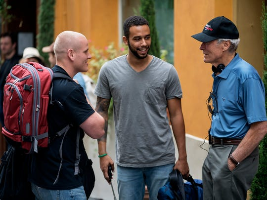 Spencer Stone, left, Anthony Sadler and director Clint Eastwood on the set of 'The 15:17 to Paris.'