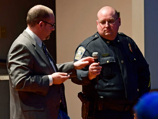 """Carroll Township Police Chief Thomas Wargo hands over the microphone to attorney Matt Menges during a concealed carry seminar on Feb. 22, 2018. State Rep. Dawn Keefer hosted the seminar at the South Mountain VFW Post 6771 in Dillsburg. """"It is essential that gun owners know their rights, as well as their responsibilities,"""" Keefer said in a press release."""