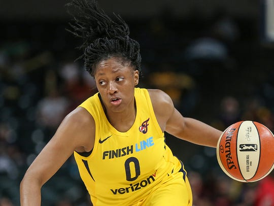Indiana Fever guard Kelsey Mitchell (0) works a possession