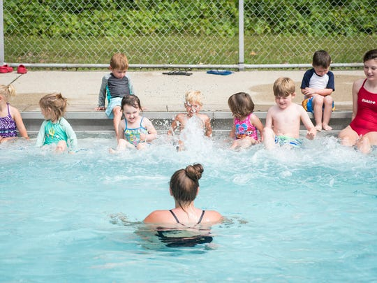 Kids kick their feet in the water Tuesday, June 19, 2018, during a swim lesson at Sanborn Park Pool in Port Huron.