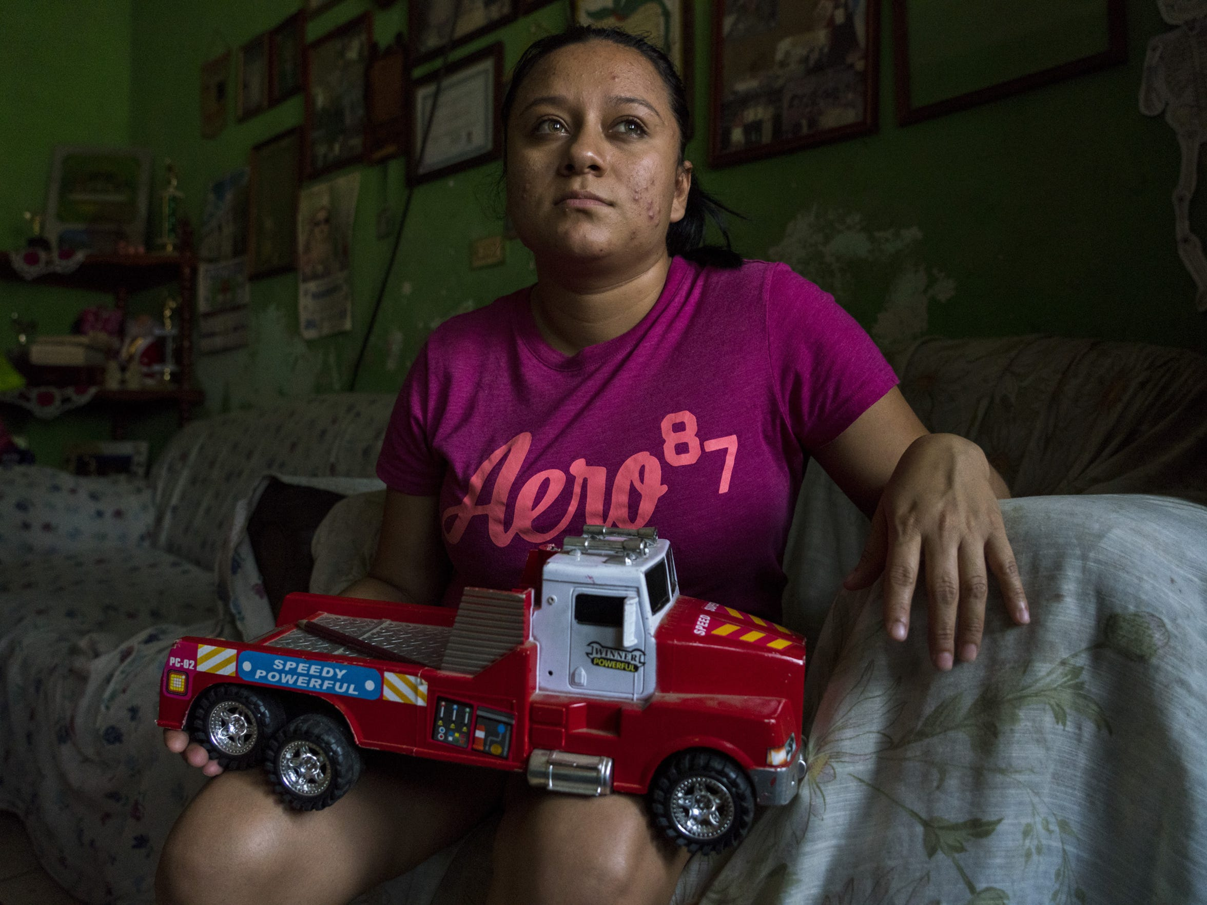 Lourdes Marianela De Leon holds her son Leo's toy at her home in Guatemala. She was deported to Guatemala without 6-year-old Leo, who remains in a New York shelter.