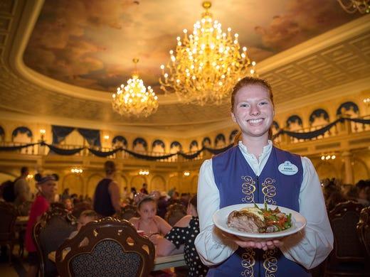 Annie Scott holds a plate of braised pork inside the