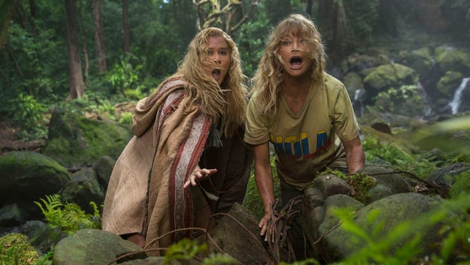 Goldie Hawn, right, and Amy Schumer fight for their lives in the new comedy 'Snatched.'